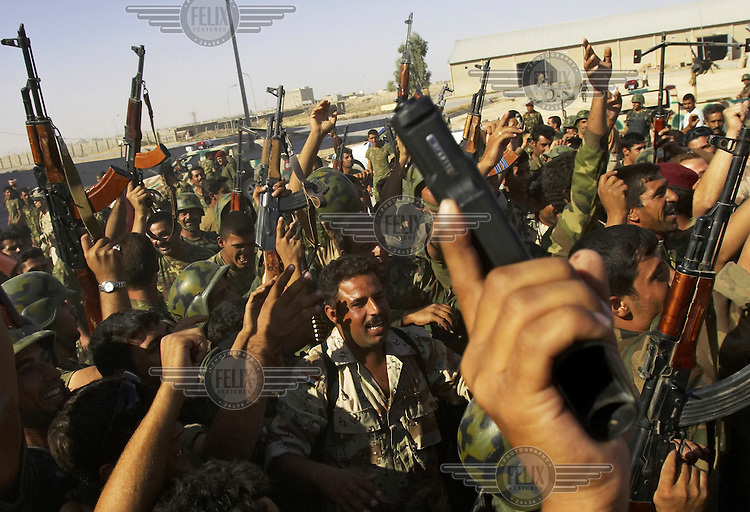 Iraqi Special Police Commandos celebrate the successful capture of suspected insurgents in Tal Afar. US Army commanders said more than 400 suspects had been captured during the offensive to retake the northern town of Tal Afar.