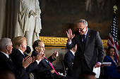 Senate Minority Leader Chuck Schumer, a Democrat from New York, waves to U.S. President Donald Trump, after greeting former Senator Bob Dole, during a congressional Gold Medal ceremony for Dole, in Washington D.C., U.S., on Wednesday, Jan. 17, 2018. From left: U.S. Vice President Mike Pence, Trump, Dole, and Schumer. Photographer: Al Drago/Bloomberg<br /> Credit: Al Drago / Pool via CNP