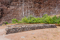Hawaiian stone wall canoe shelter in Nualolo Kai village, Na Pali Coast, Kaua'i