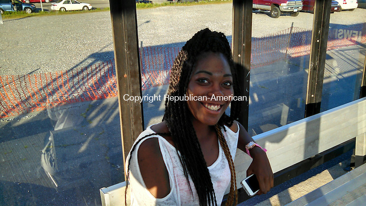 WATERBURY, CT - July 11, 2014 - 071114AL02 - Chanece Fain, of Bridgeport, has no complaints about the Waterbury branch. She said most of the conductors are friendly. Andrew Larson / Republican-American