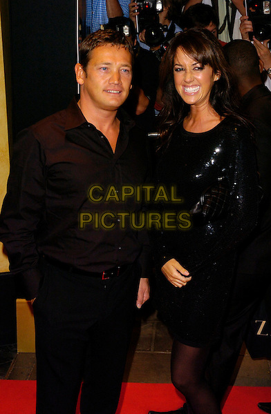 SID OWEN & SHEREE MURPHY.TV Quick & TV Choice Awards arrivals at the Dorchester Hotel, London, UK..September 4th, 2006.Ref: CAN.half length black shirt jacket smiling .www.capitalpictures.com.sales@capitalpictures.com.©Can Nguyen/Capital Pictures