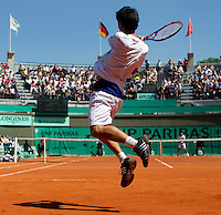 Kei Nishikori (JPN) against Novak Djokovic (SRB) (3) in the second round of the men's singles. Novak Djokovic beat Kei Nishikori 6-1 6-4 6-4..Tennis - French Open - Day 6 - Fri 29 May 2010 - Roland Garros - Paris - France..© FREY - AMN Images, 1st Floor, Barry House, 20-22 Worple Road, London. SW19 4DH - Tel: +44 (0) 208 947 0117 - contact@advantagemedianet.com - www.photoshelter.com/c/amnimages