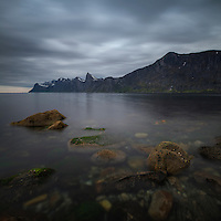 Cloudy weather over Mefjord with Segla mountain peak rising in distance, Senja, Norway