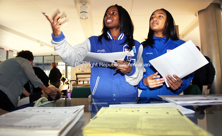 WATERBURY CT. 16 January 2015-011616SV06-From left, Di&rsquo;Azhia Small, 17, and Makayla Henley, 17, both of Waterbury try to sign up fellow student to join the NAACP local chapter during Martin Luther King Youth Day at Waterbury Career Academy in Waterbury Saturday. Youth Day was an opportunity for young folks to participate in workshops on self-sufficiency, budgeting and future career choices.<br /> Steven Valenti Republican-American