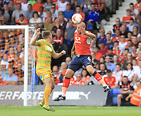Luton Town captain Scott Cuthbert heads the ball back towards his own goal during the Sky Bet League 2 match between Luton Town and Yeovil Town at Kenilworth Road, Luton, England on 13 August 2016. Photo by Liam Smith.