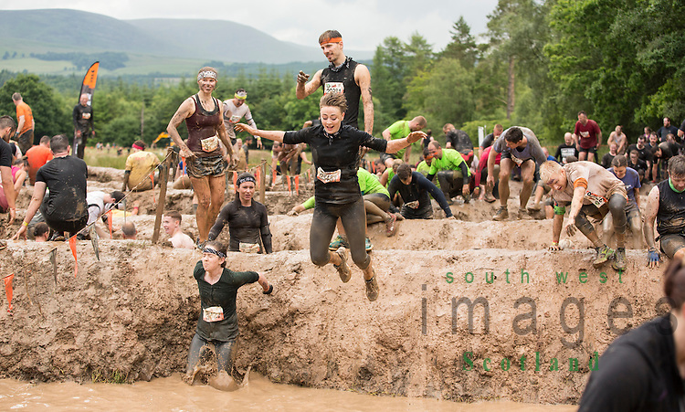 Tough Mudder at Drumlanrig Castle 2016. Participants taking part in obstacle course whilst getting cover in mud