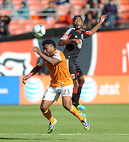 Giles Barnes (23) of the Houston Dynamo head the ball against James Riley (2) of D.C. United. The Houston Dynamo defeated D.C. United 2-1, at RFK Stadium, Saturday October 27, 2013.