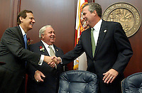 TALLAHASSEE, FL. 3/2/04-House Speaker Johnny Byrd, R-Plant City, left, joins Senate President Jim King, R-Jacksonville in greeting Gov. Jeb Bush prior to the State of the State speech Tuesday at the Capitol in Tallahassee. COLIN HACKLEY PHOTO