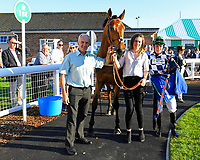 Connections of Ship of the Fen in the Winners enclosure after winning The Comec Voice & Data Handicap  during Evening Racing at Salisbury Racecourse on 25th May 2019