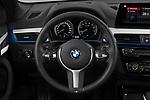Car pictures of steering wheel view of a 2020 BMW X1 M-Sport 5 Door SUV Steering Wheel