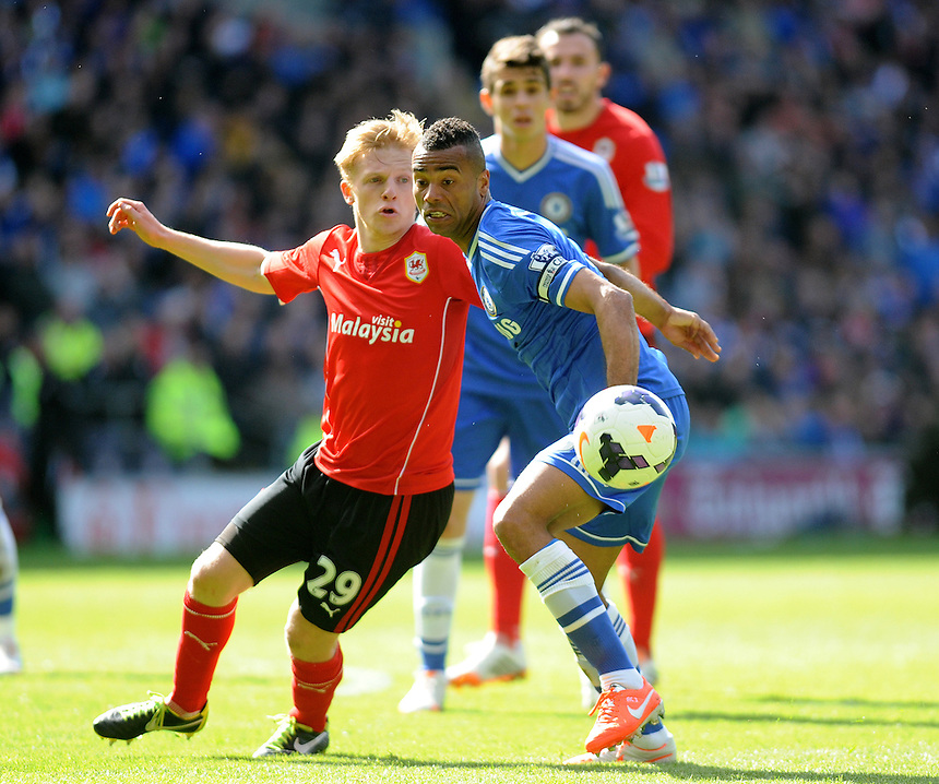 Cardiff City's Mats Moller Daehli vies for possession with Chelsea's Ashley Cole <br /> <br /> Photographer Ashley Crowden/CameraSport<br /> <br /> Football - Barclays Premiership - Cardiff City v Chelsea - Sunday 11th May 2014 - Cardifff City Stadium - Cardiff<br /> <br /> &copy; CameraSport - 43 Linden Ave. Countesthorpe. Leicester. England. LE8 5PG - Tel: +44 (0) 116 277 4147 - admin@camerasport.com - www.camerasport.com