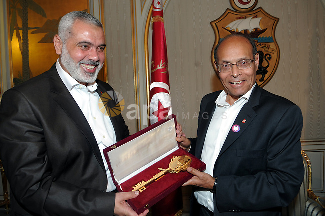 Tunisian President Moncef Marzouk receives from Gaza's Prime Minister, Ismail Haniya a miniature of Al-Quds mosque on January 5, 2012 at Carthage Palace in Tunis. Photo by Mohammed Al-Ostaz