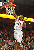 NWA Democrat-Gazette/Michael Woods --01/06/2015--w@NWAMICHAELW... University of Arkansas guard Michael Qualls goes up for a slam dunk on a fast break during the overtime period of the Razorbacks 93-91 overtime victory over Alabama during Thursday nights game at Bud Walton Arena in Fayetteville.