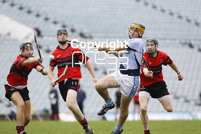 Na Piarsaigh David Sheppard gets his shot away as Adare's Ross Kennedy,David Dillon & Wayne Mcnamara try to block during their Limerick County Final played in Gaelic Ground Limerick. Pictured Credit Brian Gavin Press 22