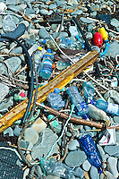 Plastic detritis and debris littering the rocks on the west coast, County Clare, West of Ireland