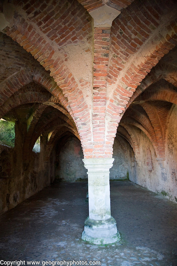 Vaulted roof and pillars in the cellar of the historic Guildhall, Blakeney, Norfolk, England