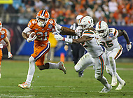 Charlotte, NC - December 2, 2017: Clemson Tigers wide receiver Ray-Ray McCloud (21) stiffs arm a Miami Hurricanes defender during the ACC championship game between Miami and Clemson at Bank of America Stadium in Charlotte, NC. Clemson defeated Miami 38-3 for their third consecutive championship title. (Photo by Elliott Brown/Media Images International)