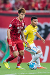 Shanghai FC Defender Shi Ke (L) in action during the AFC Champions League 2017 Round of 16 match between Shanghai SIPG FC (CHN) vs Jiangsu FC (CHN) at the Shanghai Stadium on 24 May 2017 in Shanghai, China. Photo by Marcio Rodrigo Machado / Power Sport Images