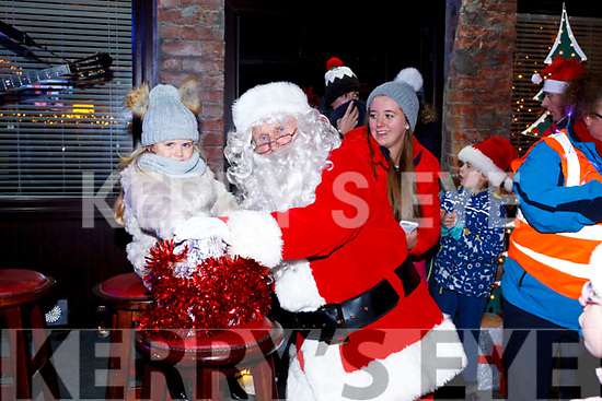 Molly Kate Mallon helps Santa push button to launch the Christmas lighting in Ballybunion on Sunday last.