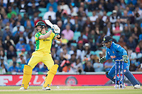 Steve Smith (Australia) gives Yuzvendra Chahal (India) the charge with MS Dhoni (India) looking for a stumping chance  during India vs Australia, ICC World Cup Cricket at The Oval on 9th June 2019