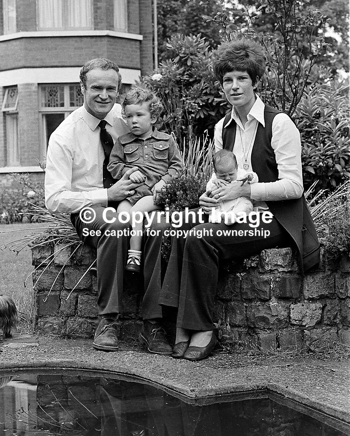 Mike Gibson, Irish, International, rugby player, with wife, Moyra Gibson, baby  daughter, Jan, 2 year old son, Colin, at their home, Belfast, N Ireland. Photo taken just before Mike Gibson left on British & Irish Lions Tour of South Africa. 351/74, 197406200351A..Copyright Image from Victor Patterson, 54 Dorchester Park, Belfast, UK, BT9 6RJ..Tel: +44 28 9066 1296.Mob: +44 7802 353836.Voicemail +44 20 8816 7153.Skype: victorpattersonbelfast.Email: victorpatterson@mac.com.Email: victorpatterson@ireland.com (back-up)..IMPORTANT: If you wish to use this image or any other of my images please go to www.victorpatterson.com and click on the Terms & Conditions. Then contact me by email or phone with the reference number(s) of the image(s) concerned.