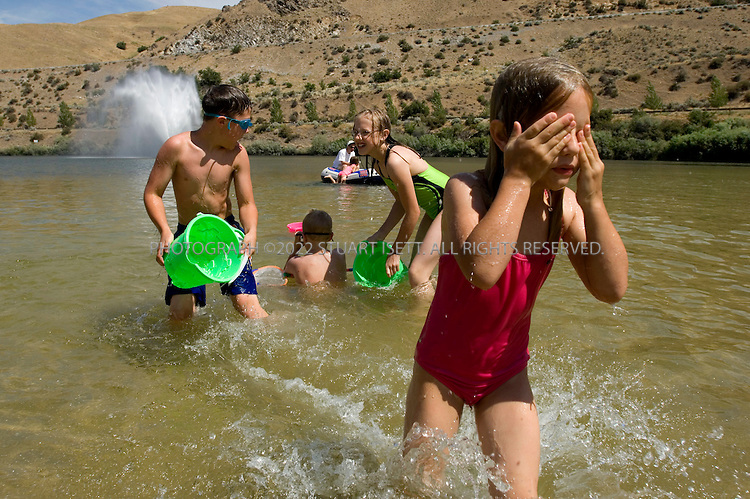 7/6/2007--Boise, Idaho, USA..Families swim at Lucky Peak State Park near Boise, Idaho. Left to right: Andrew (11) , Ethan (8), Megan (13) and Ashley (6) Heiner, children of Tiffany Heiner, play in the reservoir at the park on a day when high temperature are expected to hot 107F....Photograph ©2007 Stuart Isett.All rights reserved