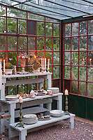 Lit candles frame the delicious meal prepared with the harvest from this very same garden and served inside the glass hosue