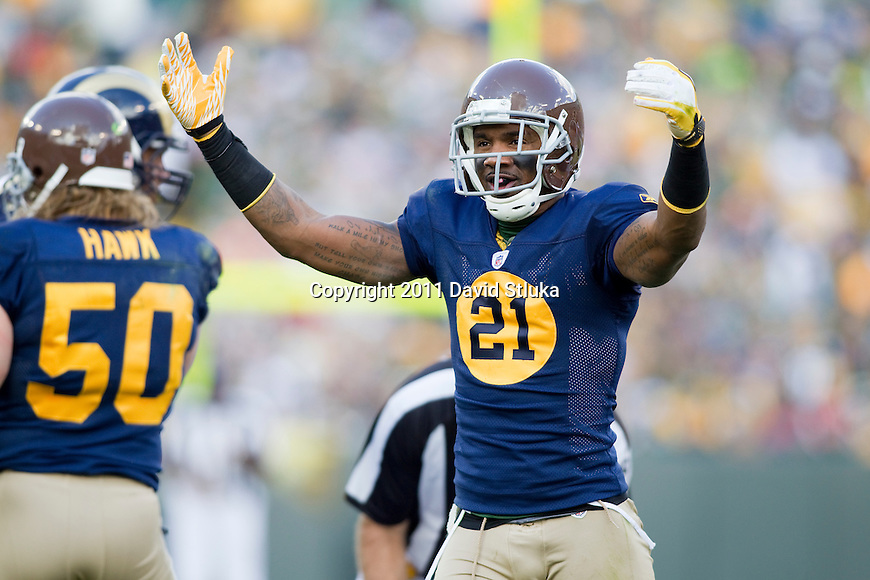 Green Bay Packers defensive back Charles Woodson (21) celebrates a turnover during a Week 6 NFL football game against the St. Louis Rams on October 16, 2011 in Green Bay, Wisconsin. The Packers won 24-3. (AP Photo/David Stluka)