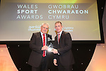 Wales Sport Awards 2013<br /> Warren Gatland receives the Coach of the Year award from Rob Howley.<br /> 09.11.13<br /> ©Steve Pope-SPORTINGWALES