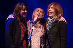 © Joel Goodman - 07973 332324 . 15/09/2013 . Bury , UK . SINEAD O'CONNOR (centre) shares the microphone with her backing singers as the closing act of the Ramsbottom Festival , in Bury , this evening (Sunday 15th September) . The singer made headlines recently after revealing new tattoos of the letters B and Q on each of the cheeks of her face . Photo credit : Joel Goodman