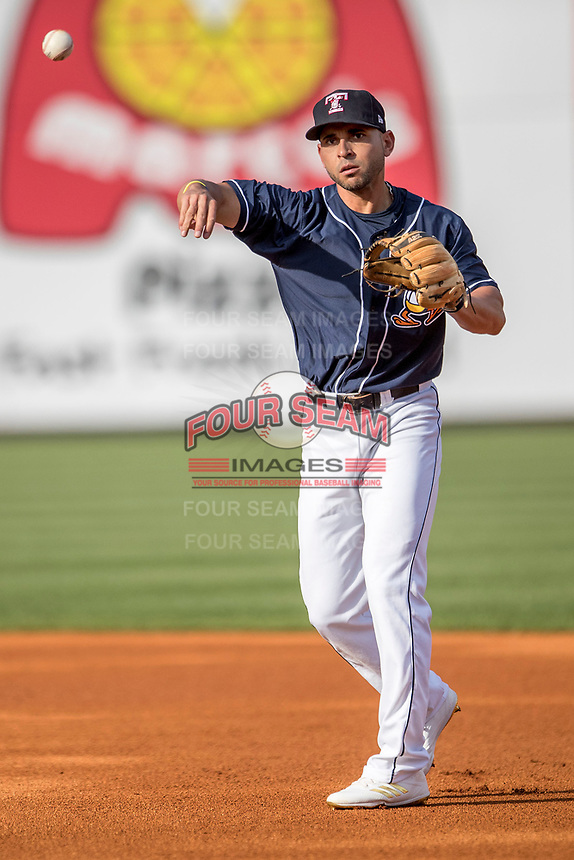 Toledo Mud Hens second baseman Omar Infante (49) makes a throw to first base against the Louisville Bats during the International League baseball game on May 17, 2017 at Fifth Third Field in Toledo, Ohio. Toledo defeated Louisville 16-2. (Andrew Woolley/Four Seam Images)