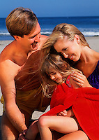 Family sharing tender moments at the beach