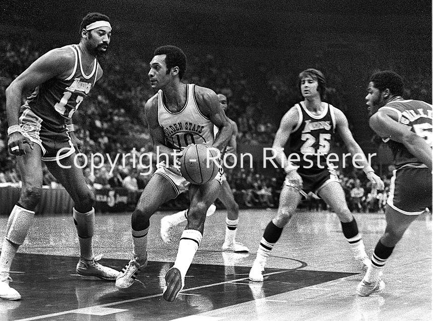 Warriors vs. Lakers:..Wilt Chamberlain guarding Warrior Charles Johnson, Gale Goodrich #25.<br />(1973 photo/Ron Riesterer)
