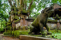 Bali, Gianyar, Ubud. Pura Prajapati, the temple of the dead in the monkey forest. Mythical animals is guarding the entrance.