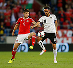 Ben Davies of Wales tussles with Martin Harnik of Austria during the World Cup Qualifying Group D match at the Cardiff City Stadium, Cardiff. Picture date 2nd September 2017. Picture credit should read: Simon Bellis/Sportimage