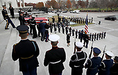 A U.S. military honor guard team carries the flag draped casket of former U.S. President George H. W. Bush from the U.S. Capitol December 5, 2018 in Washington, DC. A funeral service will be held today for former U.S. President Bush at the Washington National Cathedral. President Bush will be buried at his final resting place at the George H.W. Bush Presidential Library at Texas A&M University in College Station, Texas. A WWII combat veteran, Bush served as a member of Congress from Texas, ambassador to the United Nations, director of the CIA, vice president and 41st president of the United States.<br /> Credit: Win McNamee / Pool via CNP