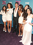 LOS ANGELES, CA - DECEMBER 19: Simon Cowell and Fifth Harmony arrive at Fox's 'The X Factor' Season Finale Night 1 at CBS Televison City on December 19, 2012 in Los Angeles, California.