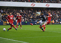 Lee Gregory of Millwall scores his side's 2nd goal to make not 2-0 during the Sky Bet Championship match between Millwall and Nottingham Forest at The Den, London, England on 30 March 2018. Photo by Alan  Stanford / PRiME Media Images.