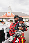 Allen Underwood, 23, stands with his son Amarion Lucky, 2, outside of Fuller's Supermarket Super Saver on March 1, 2013 in Greensboro, Alabama, where over a quarter of the population receives Social Security Disability benefits. Mr. Underwood receives Social Security Disability benefits after an accident he suffered while working at a factory in a nearby town in 2008. His mother and grandmother receive the benefits, as well.