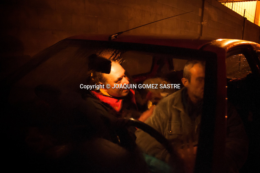 Ivanov and a friend both Bulgarians share the car in which they sleep in an industrial area of Santander (Spain).photo © JOAQUIN GOMEZ SASTRE