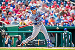 29 April 2017: New York Mets catcher Travis d'Arnaud hits into an RBI fielder's choice in the 5th inning against the Washington Nationals at Nationals Park in Washington, DC. The Mets defeated the Nationals 5-3 to take the second game of their 3-game weekend series. Mandatory Credit: Ed Wolfstein Photo *** RAW (NEF) Image File Available ***