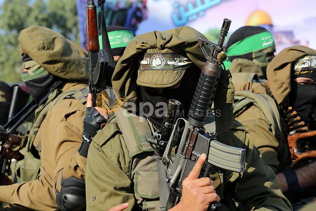 Palestinian militants of the Ezzedine al-Qassam Brigades, the armed wing of the Hamas movement, stand guard during a parade to mark the 28th anniversary of the Islamist movements creation on December 11, 2015, in the Jabalia refugee camp, in northern Gaza. Photo by Mohammed Asad