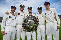 From left, Fraser Colson, Iain McPeake, Troy Johnson, Rachin Ravindra and Ben Sears. The Wellington Firebirds celebrate winning the 2019-2020 Plunket Shield at Basin Reserve in Wellington, New Zealand on Thursday, 19 March 2020. Photo: Dave Lintott / lintottphoto.co.nz