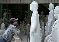 Marble and stone Buddha manufacturing in Mandalay, Myanmar, Burma.
