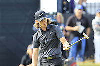 Tommy Fleetwood (ENG) takes his birdie putt on the 14th green during Thursday's Round 1 of the 145th Open Championship held at Royal Troon Golf Club, Troon, Ayreshire, Scotland. 14th July 2016.<br /> Picture: Eoin Clarke | Golffile<br /> <br /> <br /> All photos usage must carry mandatory copyright credit (&copy; Golffile | Eoin Clarke)