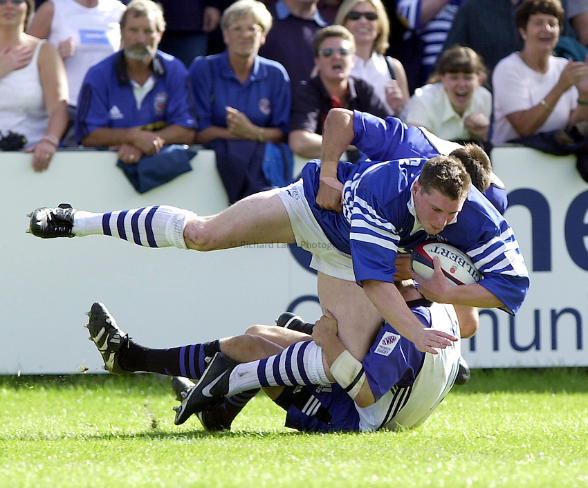 Photo. Richard Lane. .Sale v Bath. 19/8/2000. Zurich Premiership..Steve Hanley is taken down by Mike Tindal and Rob Thirlby.