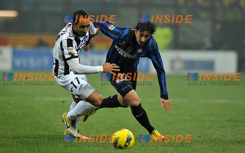 "Diego MILITO (Inter), Mouttaqui BENATIA AI (Udinese)..Milano 3/12/2011 Stadio ""Giuseppe Meazza""..Serie A 2011/2012..Football Calcio Inter Vs Udinese..Foto Insidefoto Alessandro Sabattini.."
