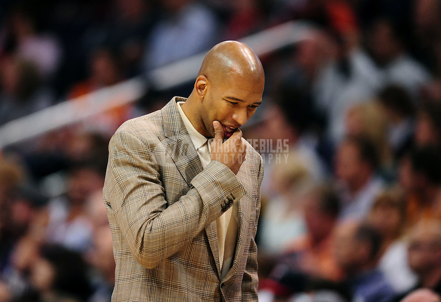 Mar. 25, 2011; Phoenix, AZ, USA; New Orleans Hornets head coach Monty Williams reacts in the first half against the Phoenix Suns at the US Airways Center. Mandatory Credit: Mark J. Rebilas-