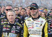 Jul. 5, 2008; Daytona Beach, FL, USA; NASCAR Sprint Cup Series driver Paul Menard (right) and teammate Mark Martin pose for a photo prior to the start of the Coke Zero 400 at Daytona International Speedway. Mandatory Credit: Mark J. Rebilas-