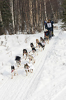 Ken Anderson w/Iditarider on Trail 2005 Iditarod Ceremonial Start near Campbell Airstrip Alaska SC